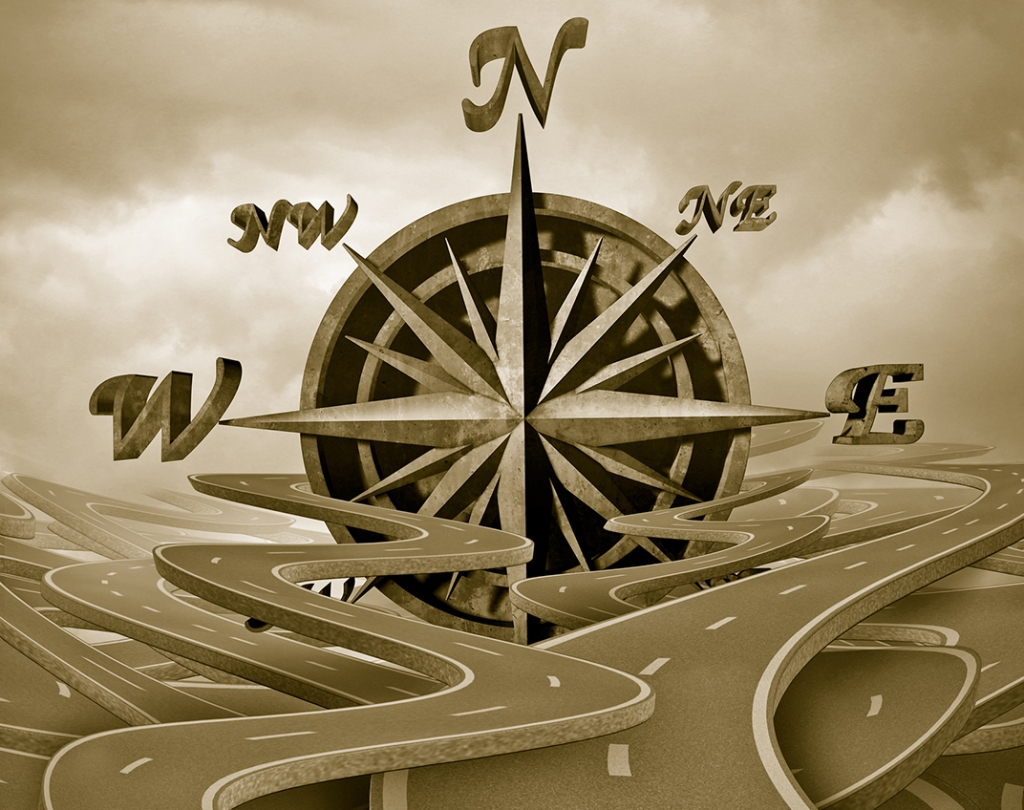 Image of compass and diverging roadways